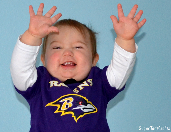 Baby signaling a touchdown