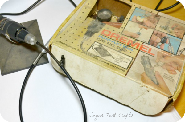 picture of an old dirty dremel tool