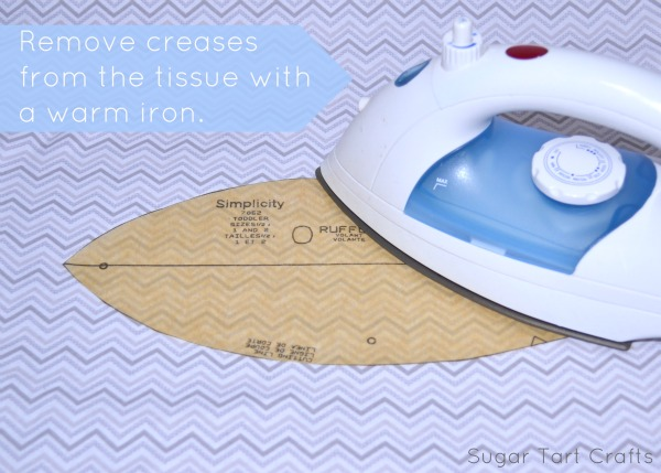Remove creases from the pattern piece with a warm iron.