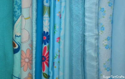Row of folded blue fabric