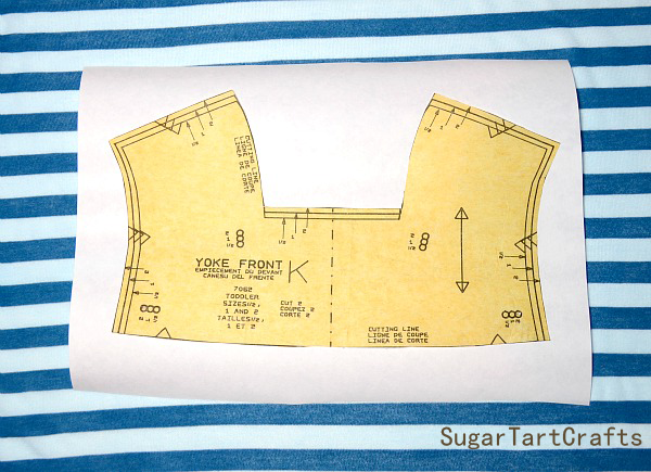 A pattern piece that needs to be cut from slippery knit fabric
