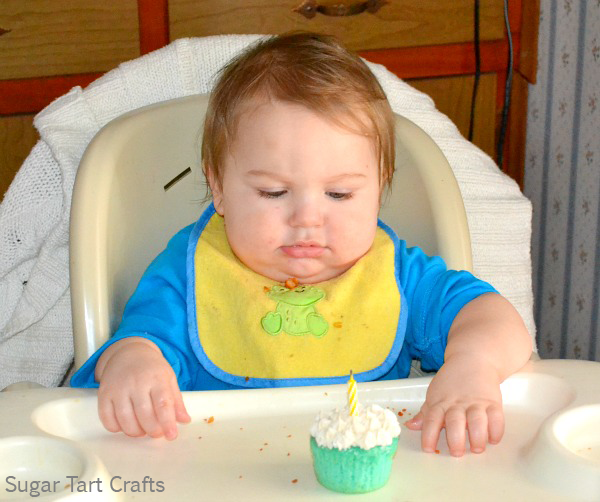 one year old boy with a cupcake