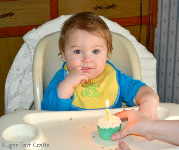 one year old with a cupcake