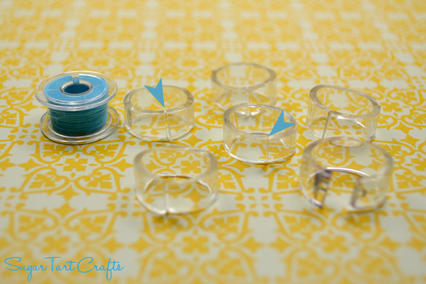 Cut plastic tubing into C shapes to control bobbin tails