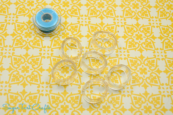 Cut plastic tubing cut into rings to keep bobbin tails under control.