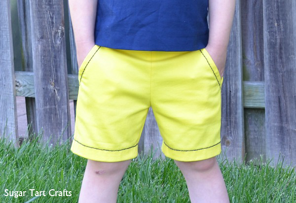 Homemade yellow shorts with navy running stitch embroidery