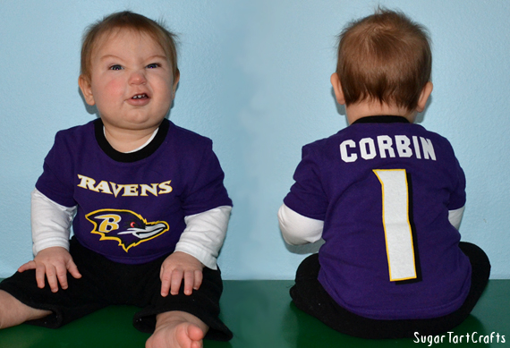 Baby in a Baltimore Raven's shirt