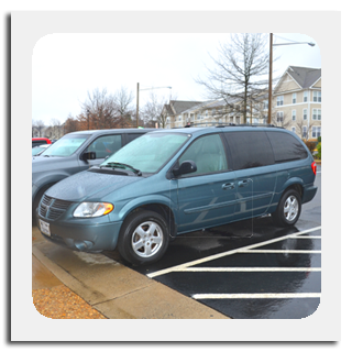 Picture of a blue grey Dodge Grand Caravan