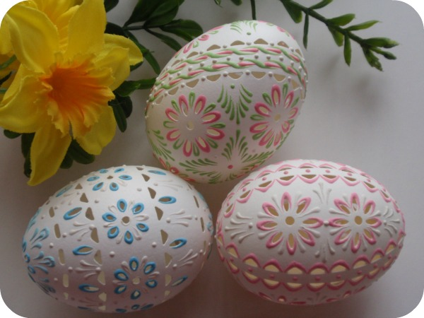 Three beautiful pysanky eggs painted and carved by EggstrArt