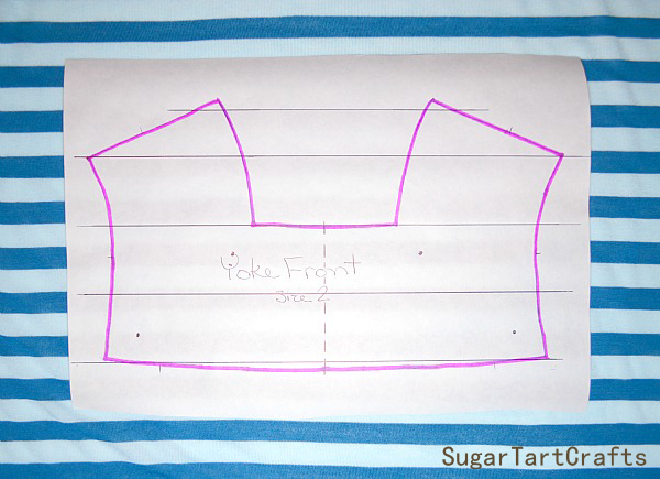 A pattern with lines drawn on it to help match the fabric stripes