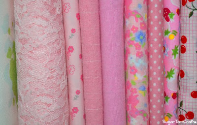 Row of folded pink fabric