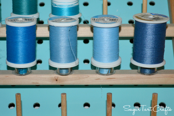 Store bobbins on the thread rack under their matching spools